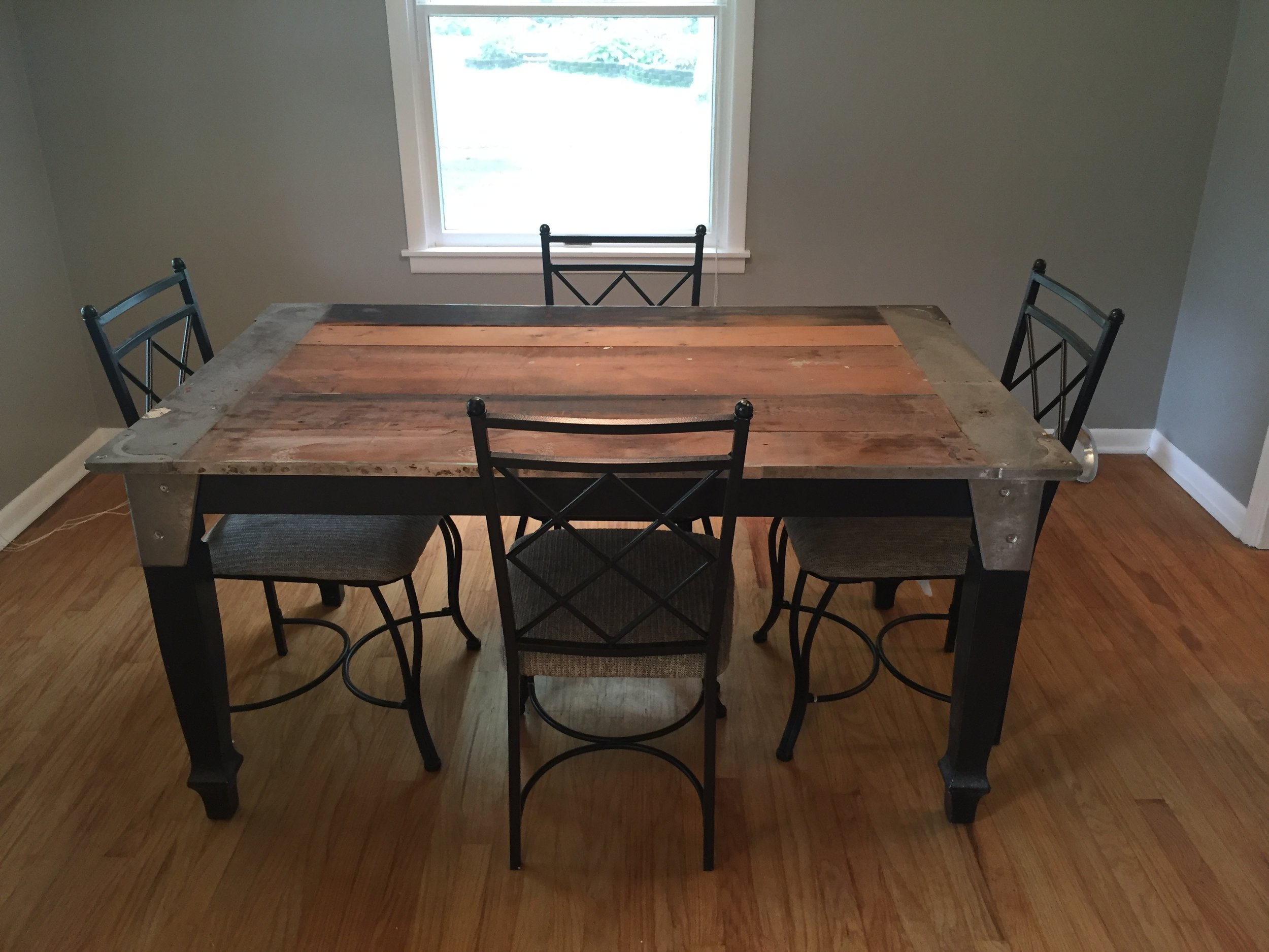 The dining room table Aaron made me. He even engineered a way for it to have an extension! He salvaged trim details from our old pool table in the basement of  old house  and used them on the table. I love it madly.