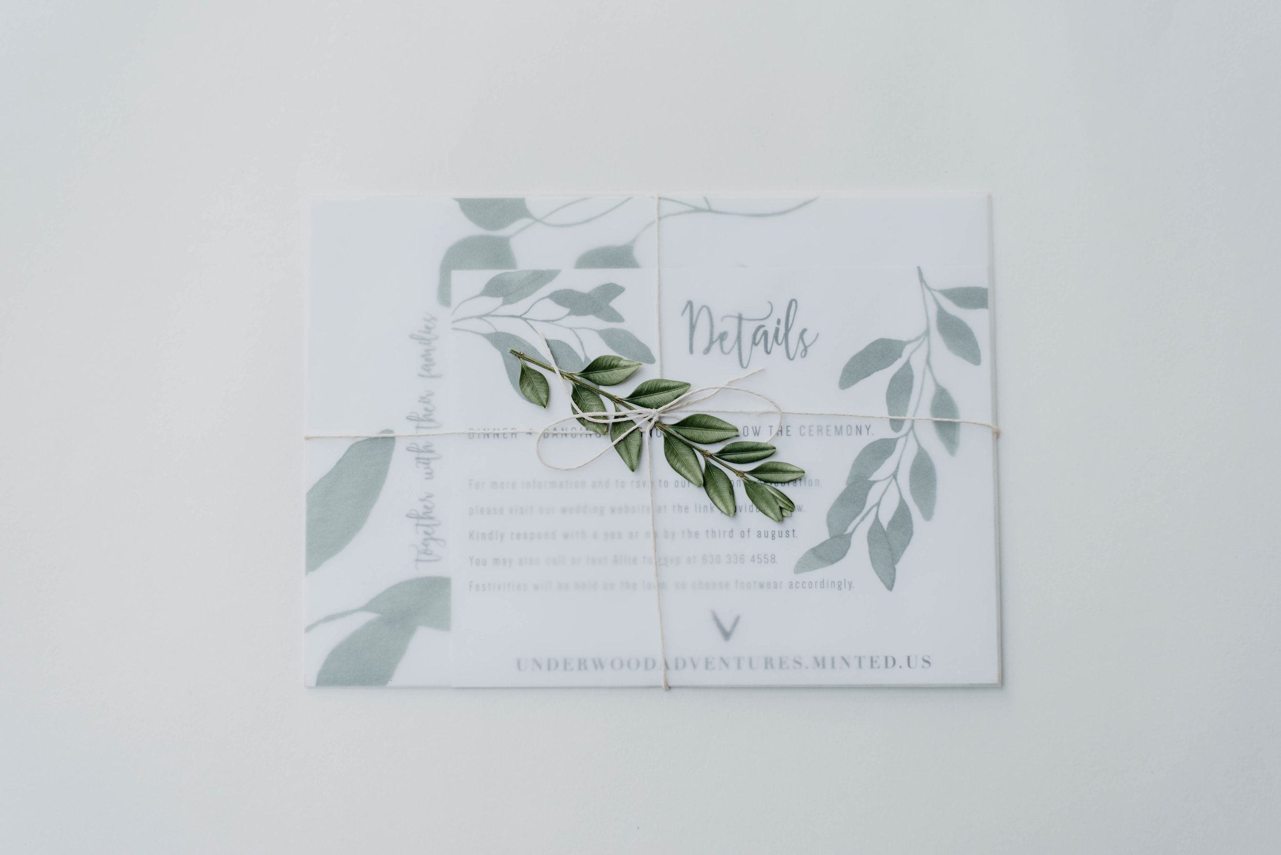 Greenery wedding invitation suite put together.