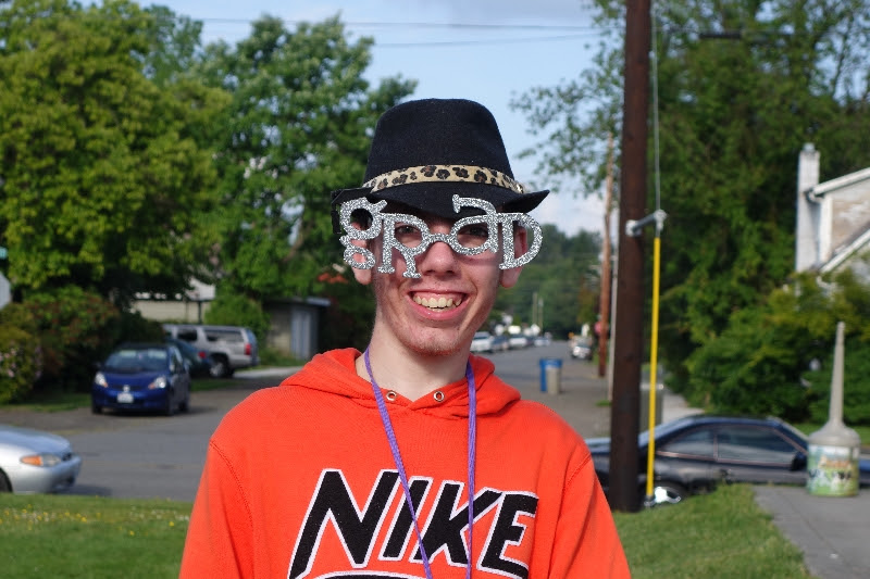 Josh with grad glasses.jpg