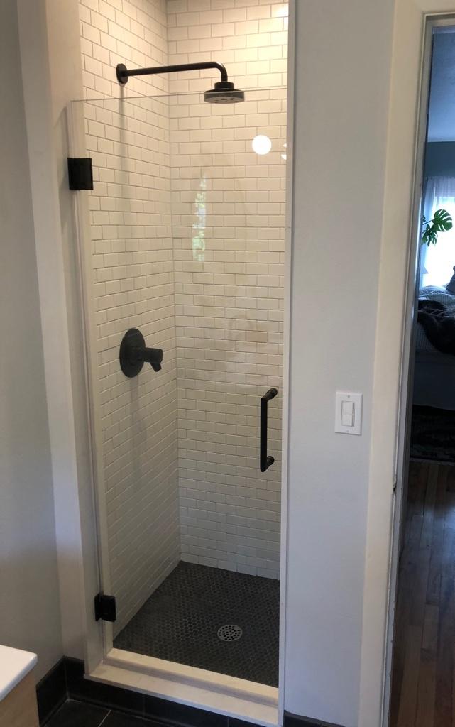 Tile stall, glass door, rain shower head
