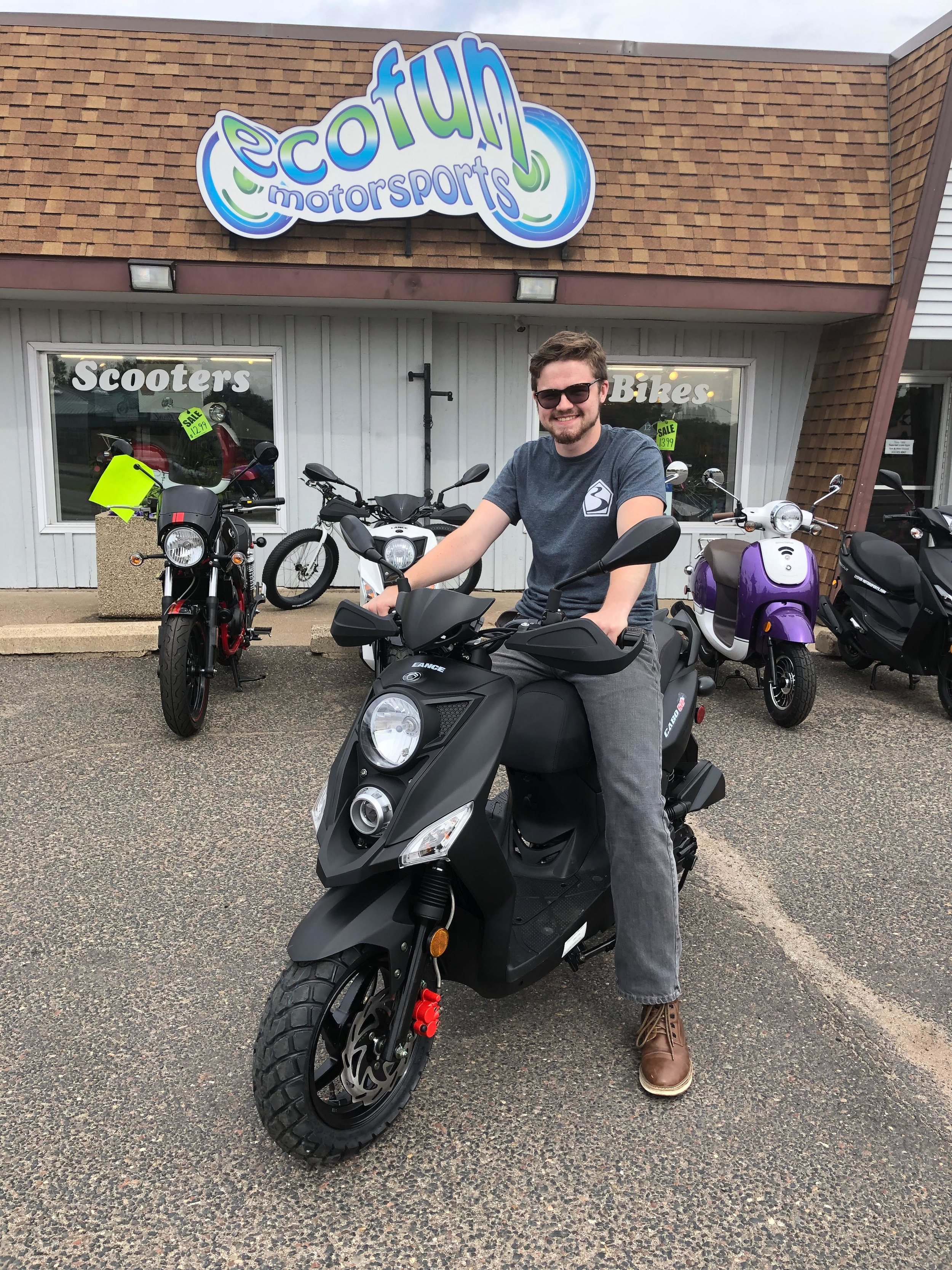 Michael M. - Sales - Michael is a Sales Associate who loves to find our customers the perfect product that fits their needs. His favorite scooter is the Lance Cabo in Stealth Black. During his free time he enjoys movies, podcasting, and traveling.