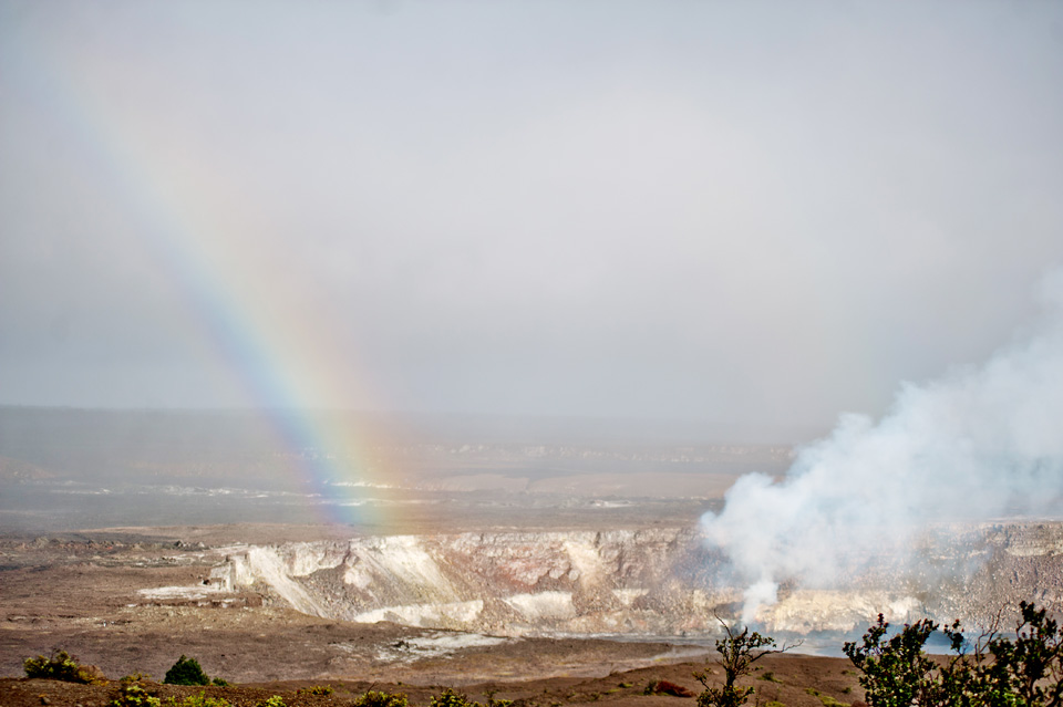 Rainbow drops into the Crater at Volcano National Park on the Big Island of Hawai'i