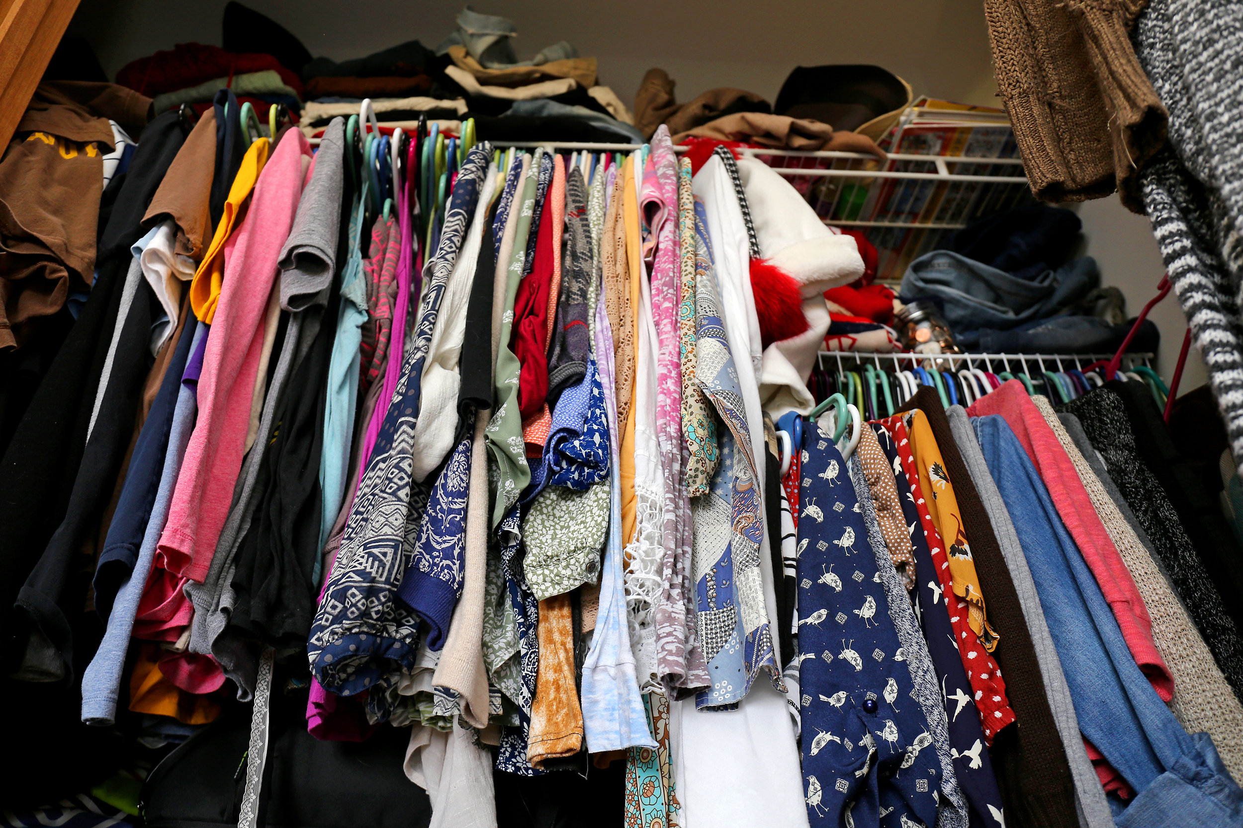 Canva - Messy Women's Closet Filled with Colorful Clothes.jpg