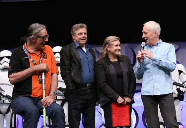 From left to right, Peter Mayhew (Chewbacca), Mark Hamill (Luke Skywalker), Carrie Fisher (Princess Leia), and Anthony Daniels (C-3PO) at Star Wars Celebration 2015.