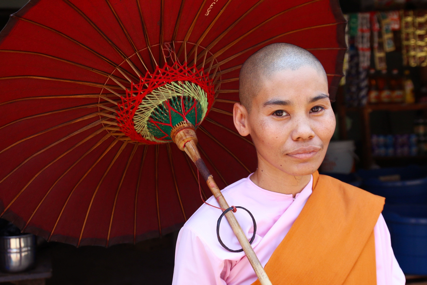 """A Buddhist """"lady monk"""" collects alms in a poor community."""