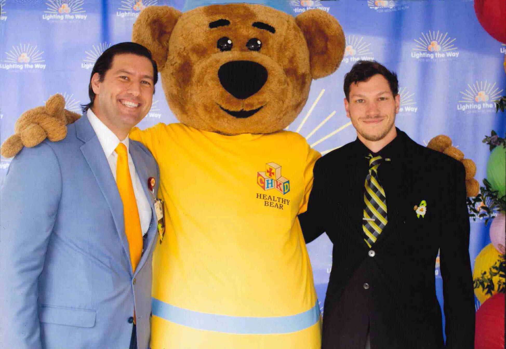 Tuna Baklan from CHKD, the CHKD Healthy Bear, and  Jonathan Hiser, Project Architect