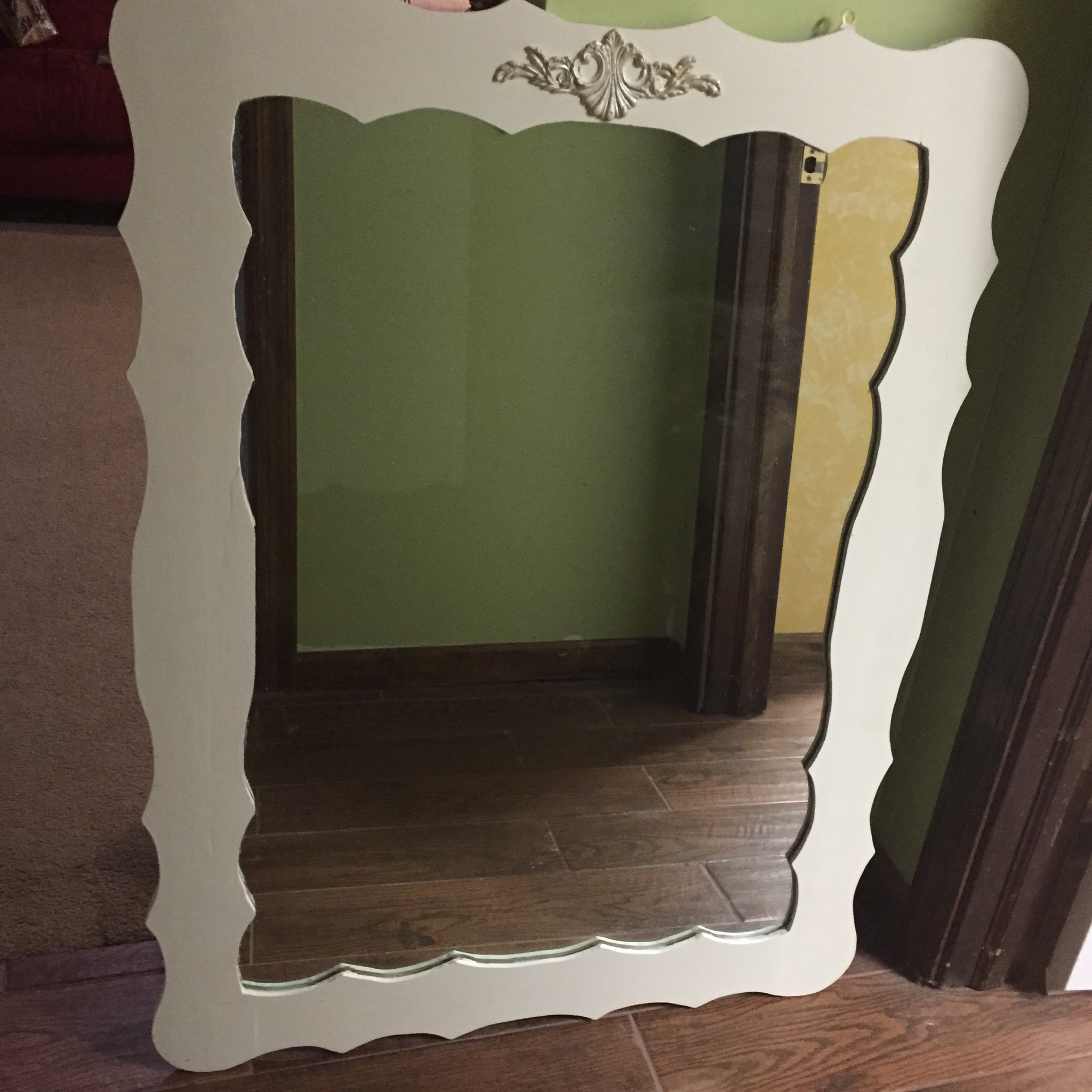 A old mirror that had stickers on it got a makeover to match the rest of the furniture.  The wood Dixie Belle applique , also sold at LaVintage Decor Studio was applied to the top of the mirror and given the Silver Shine treatment.