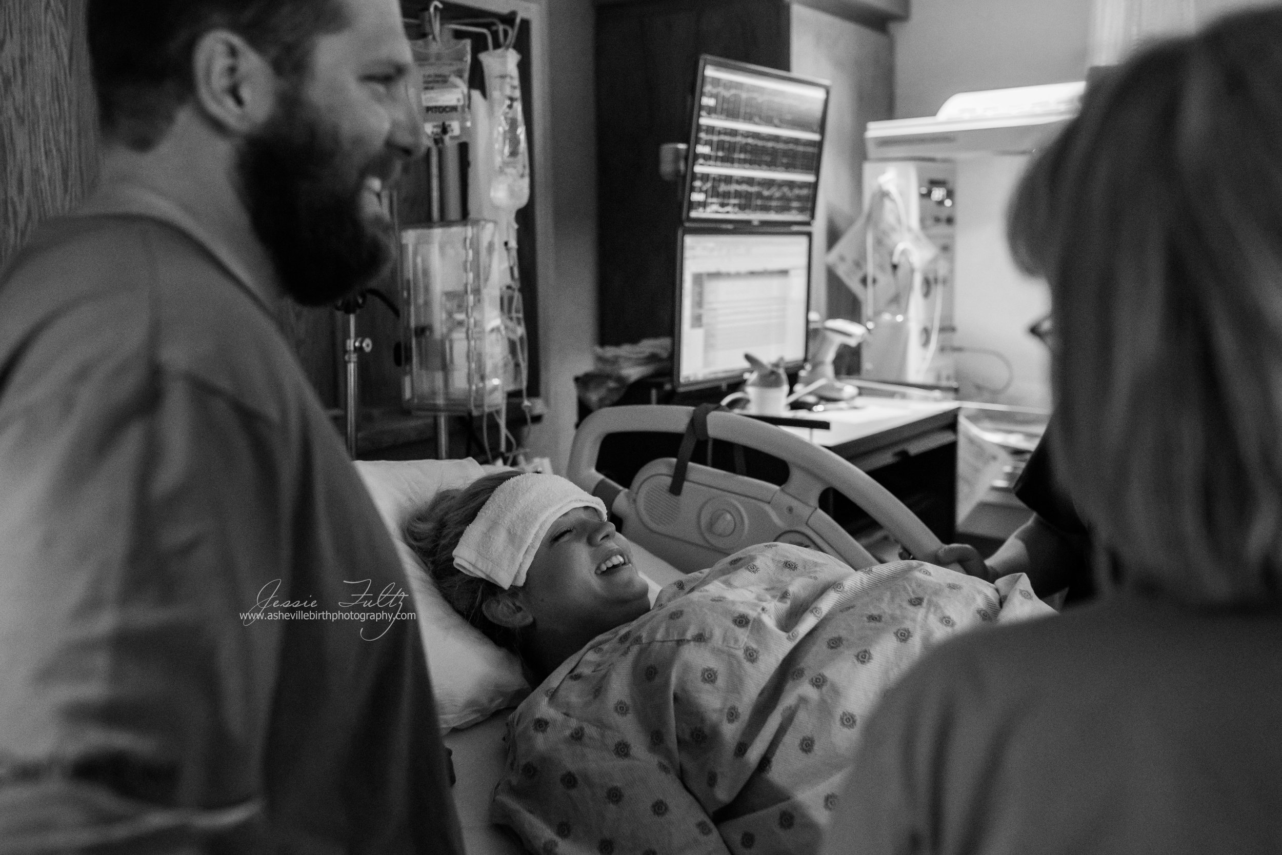 laboring woman and husband smiling between contractions