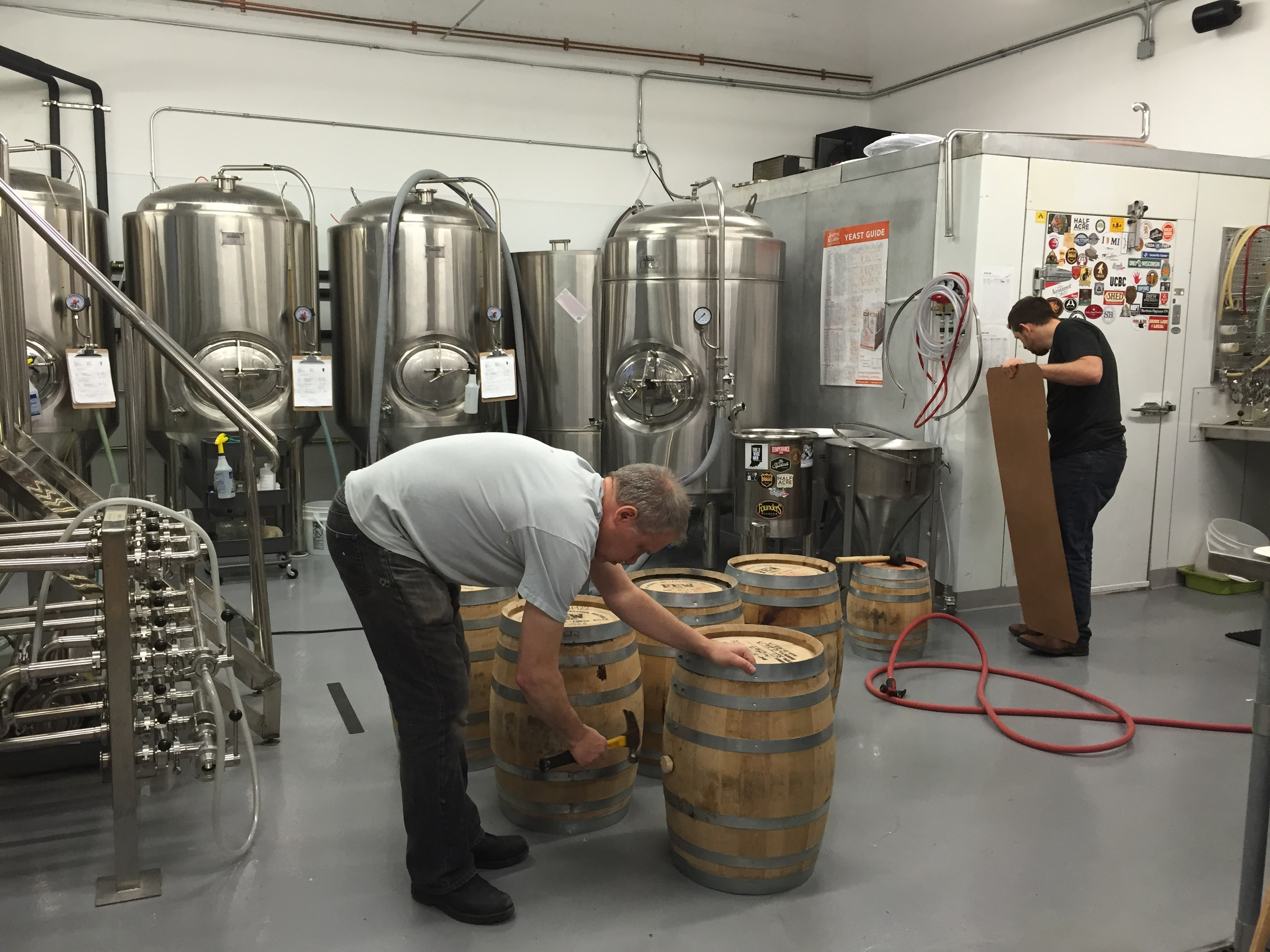 Shawn and Cesar prepping our Few Barrels to hold the Lapwing (Strong Scotch Ale).