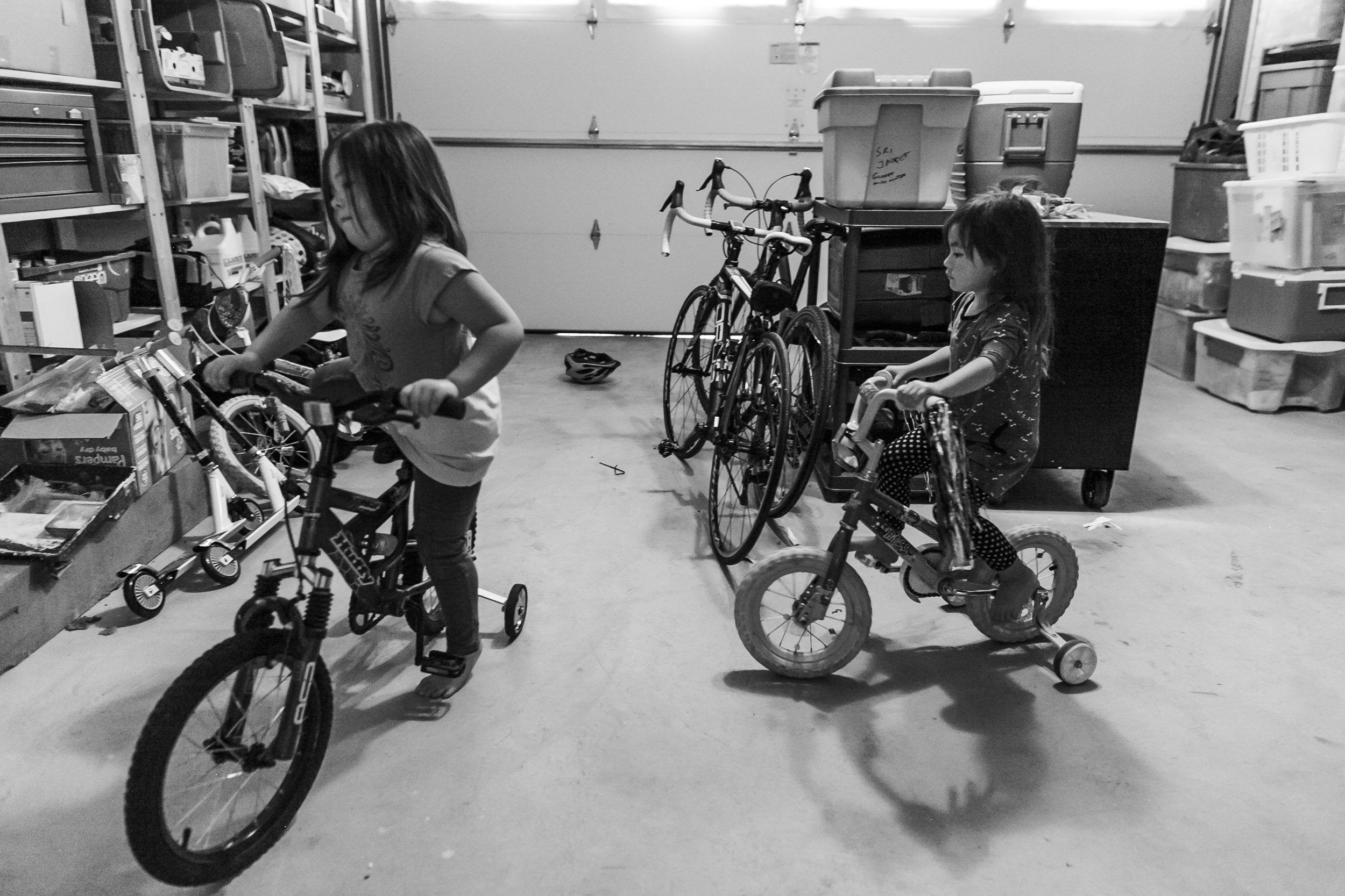 Surrey Family photographer. Vancouver family photographer, klutch Photography, documentary photography, candid photography, riding bikes in the garage