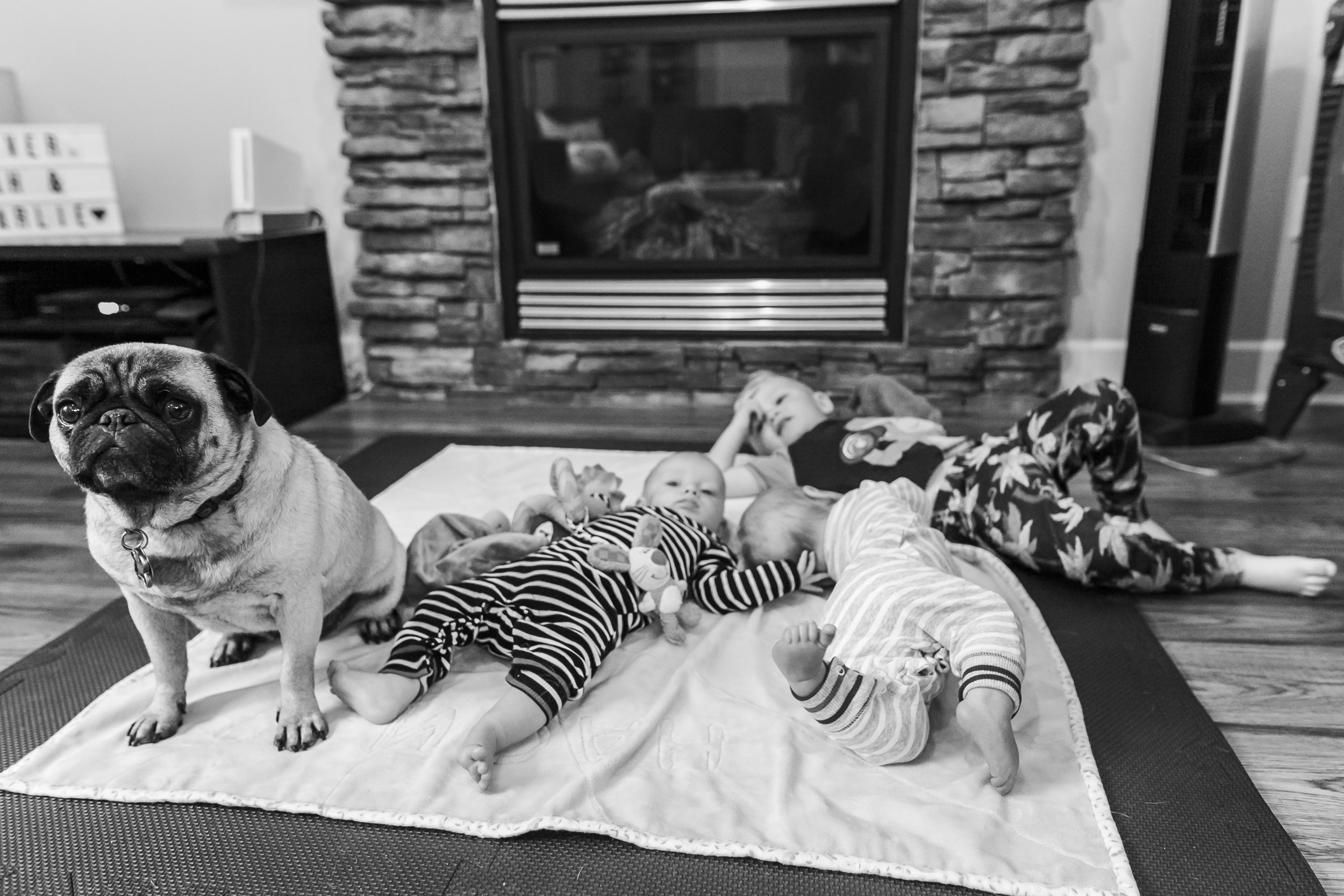 Surrey Family photographer. Vancouver family photographer, klutch Photography, documentary photography, candid photography, kids laying on a mat