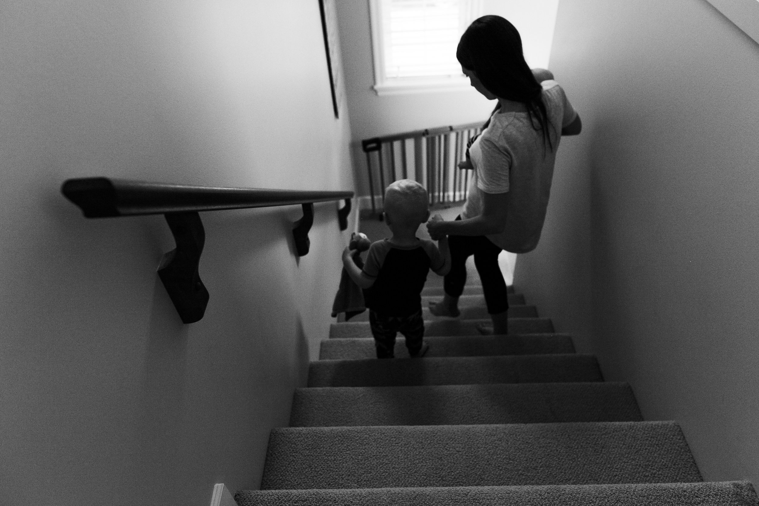 Surrey Family photographer. Vancouver family photographer, klutch Photography, documentary photography, candid photography, mom going down the stairs