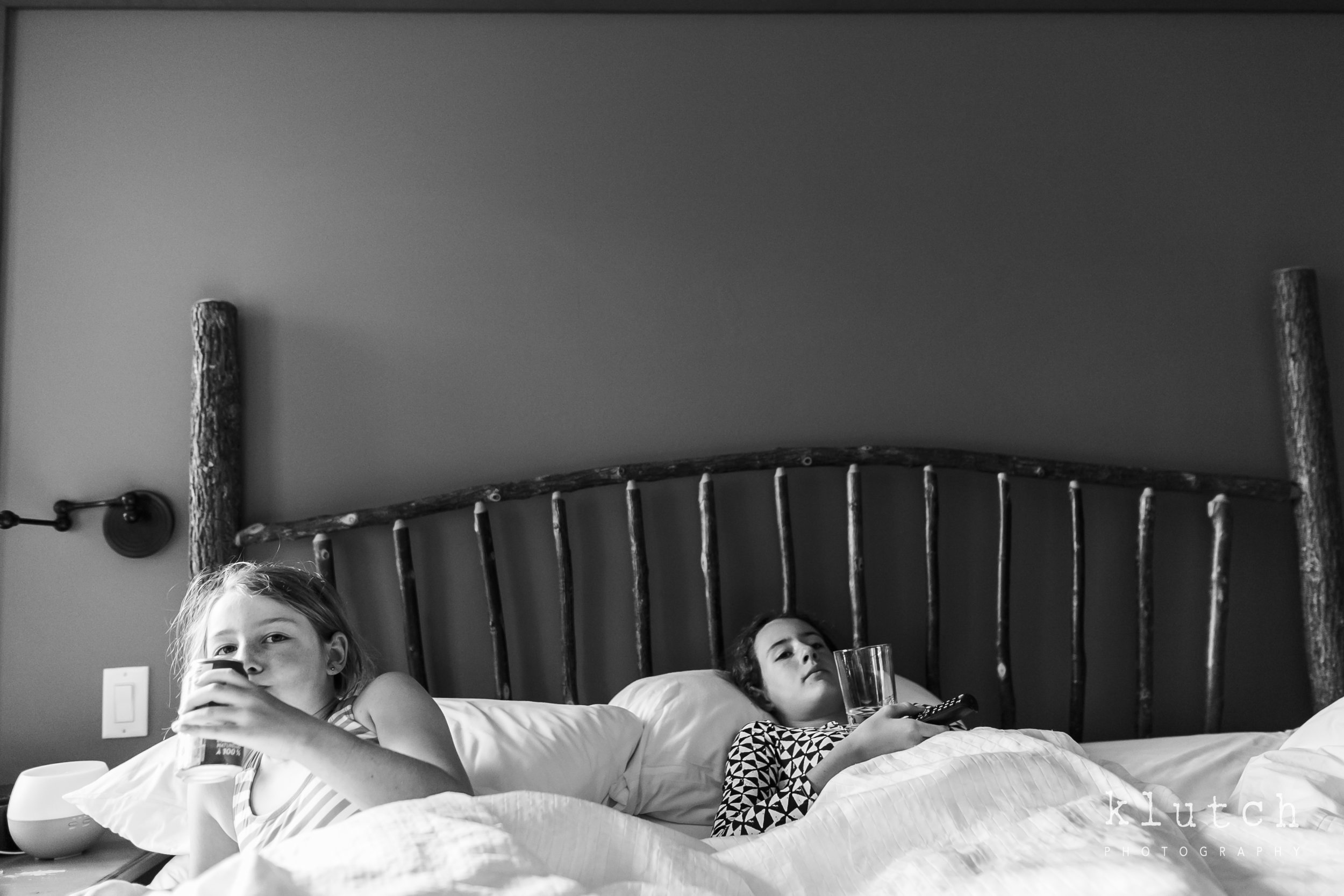 Surrey Family Photographer. Vancouver family photographer, klutch Photography, documentary photography, Vancouver documentary photographer, candid photography, lifestyle photographer, a day in the life session, family photography, Vancouver Photographer, Surrey Family Photographer, White Rock family Photographer, Dina Ferreira Stoddard-girl watching tv in bed-6062.jpg