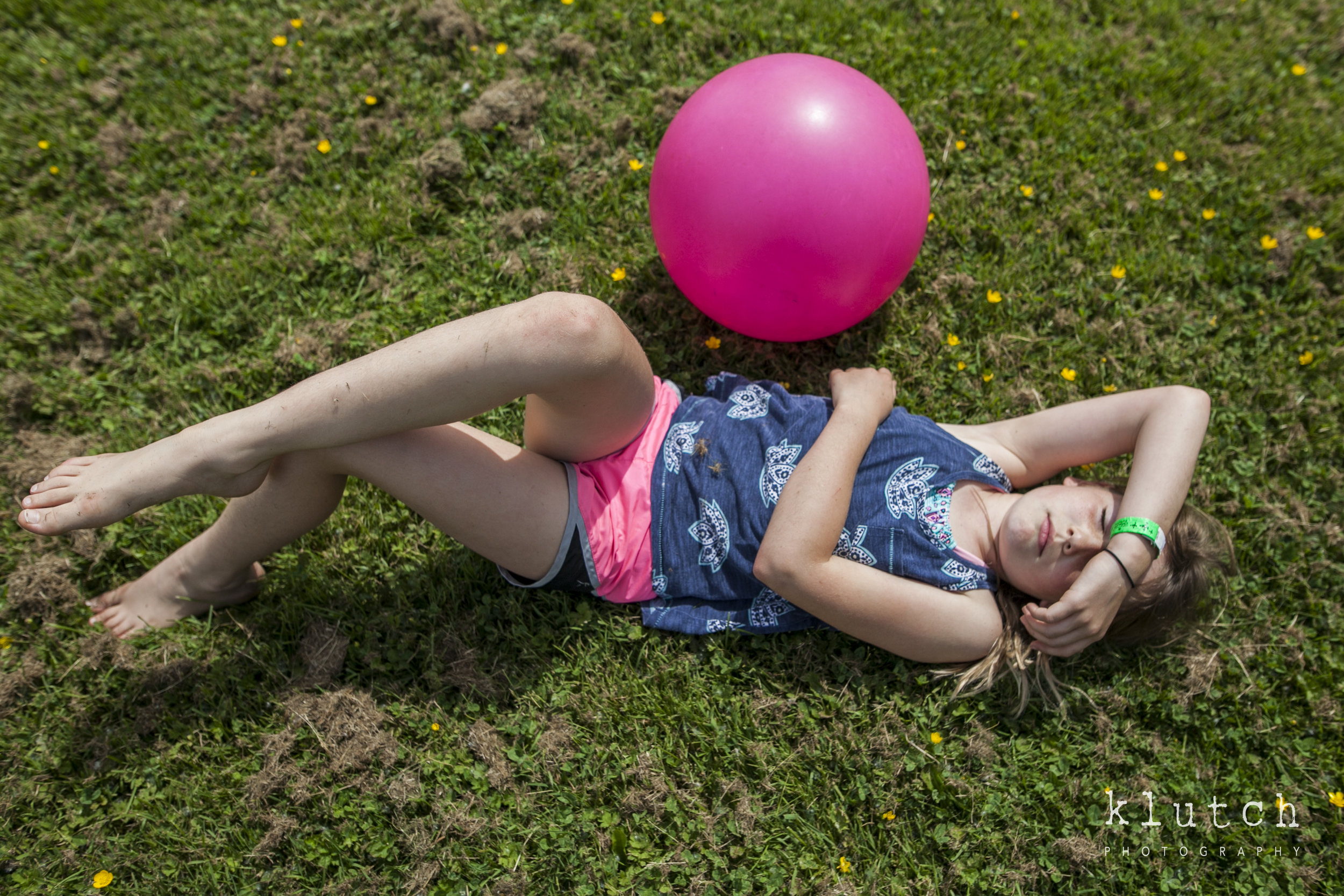 Surrey Family Photographer. Vancouver family photographer, klutch Photography, documentary photography, Vancouver documentary photographer, candid photography, lifestyle photographer, a day in the life session, family photography, Vancouver Photographer, Surrey Family Photographer, White Rock family Photographer, Dina Ferreira Stoddard, girl laying on grass with ball-5730.jpg