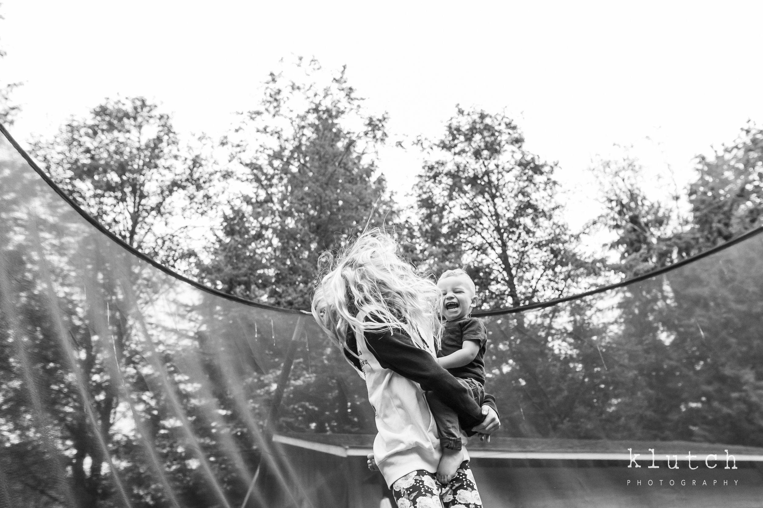 Surrey Family Photographer. Vancouver family photographer, klutch Photography, documentary photography, Vancouver documentary photographer, candid photography, lifestyle photographer, a day in the life session, family photography, Vancouver Photographer, Surrey Family Photographer, White Rock family Photographer, Dina Ferreira Stoddard, little boy bouncing with sister-0186.jpg