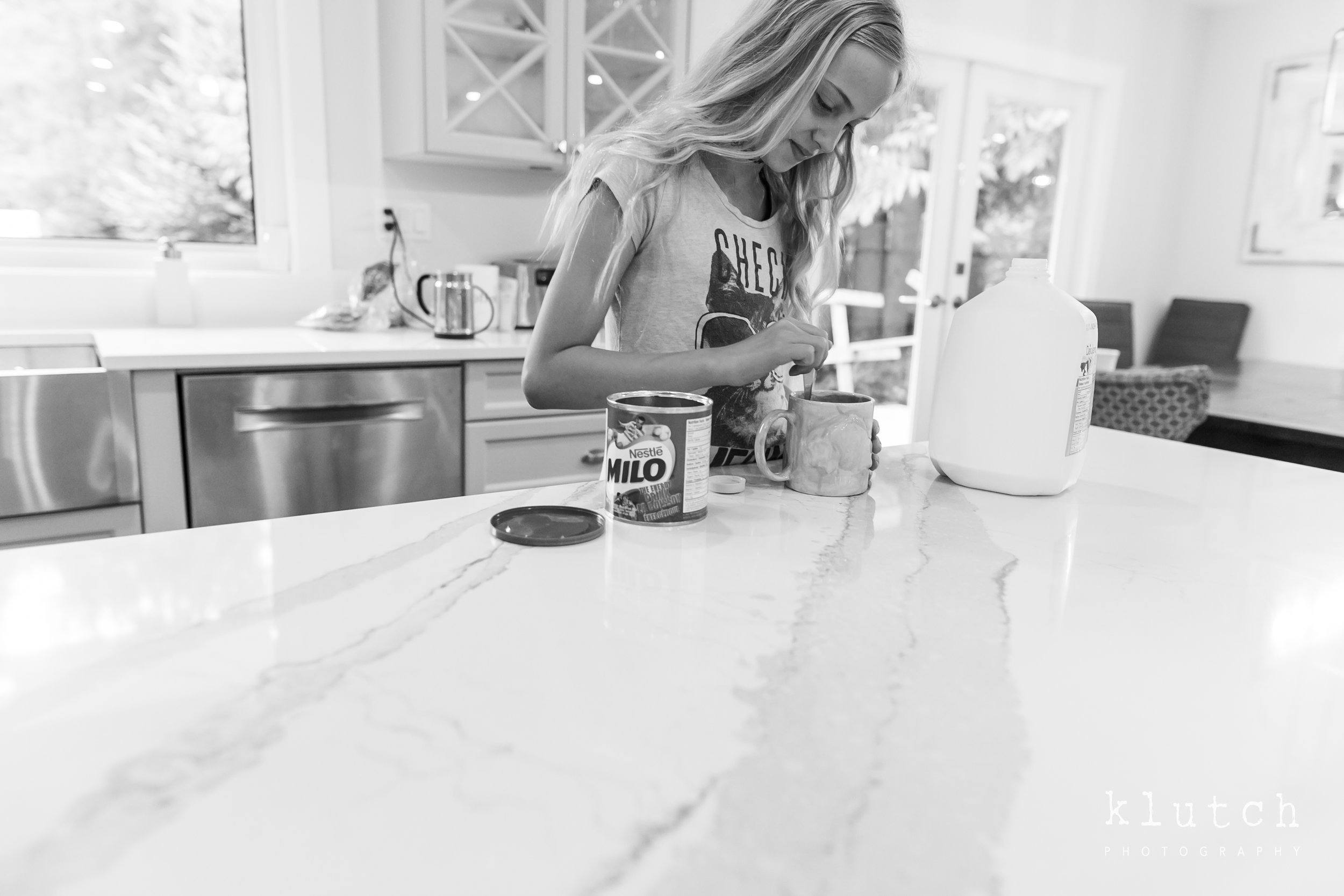 Surrey Family Photographer. Vancouver family photographer, klutch Photography, documentary photography, Vancouver documentary photographer, candid photography, lifestyle photographer, a day in the life session, family photography, Vancouver Photographer, Surrey Family Photographer, White Rock family Photographer, Dina Ferreira Stoddard, girl making chocolate milk-9838.jpg
