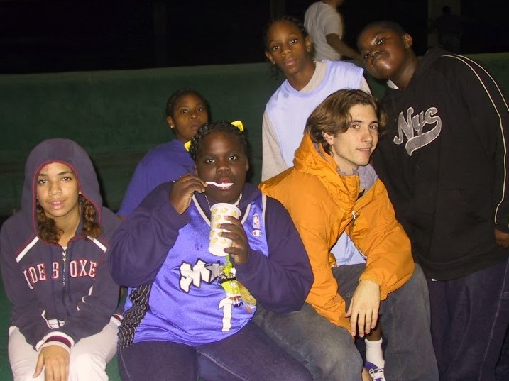 Seth along with some Learning Center students at a Roller Skating Night circa 2003.