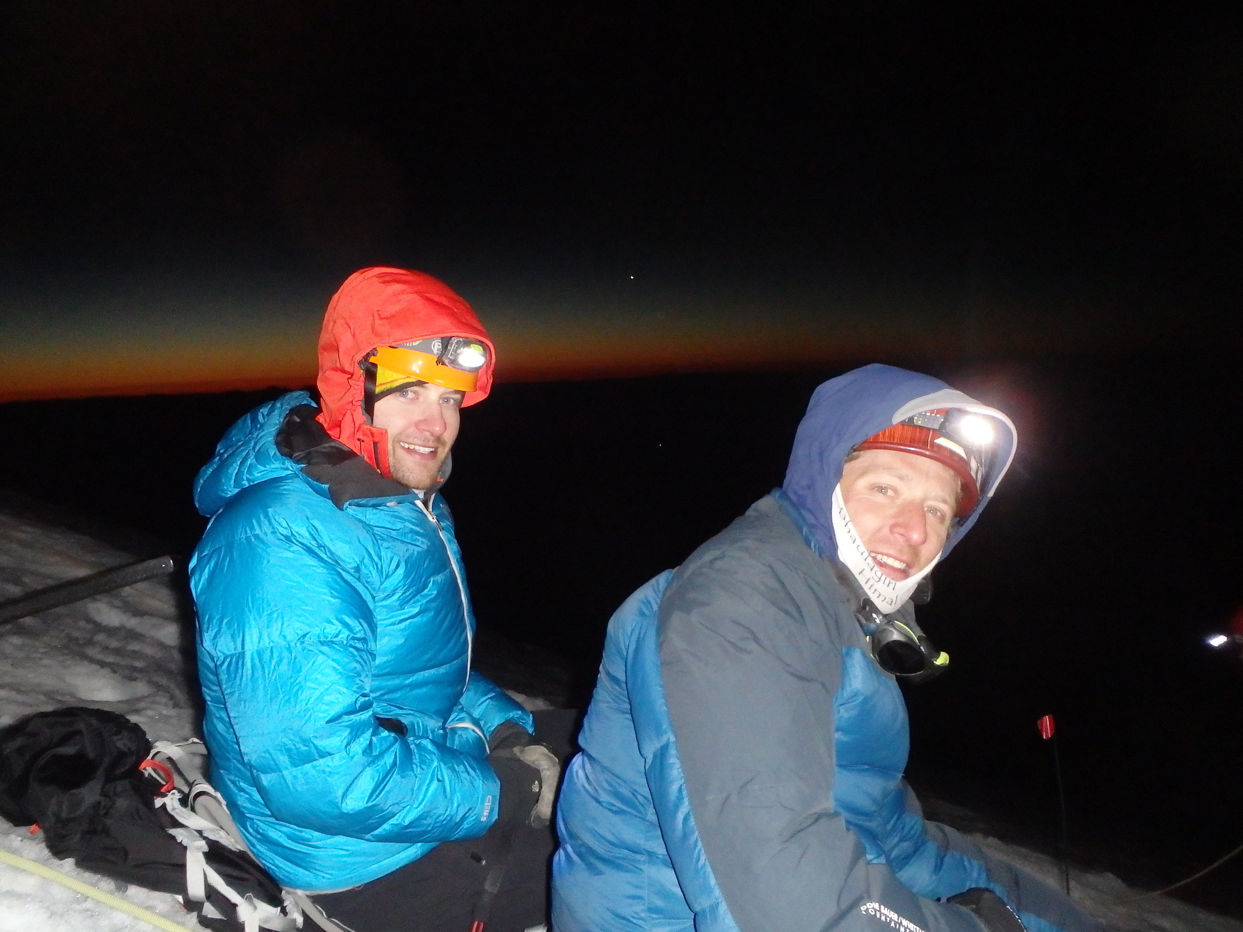 Nick and I on the ascent. The sun rising in the background.
