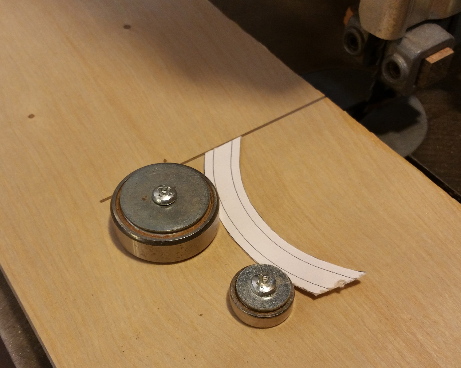 Use router bearings or other discs, and allow room for adjustment when screwing them down.