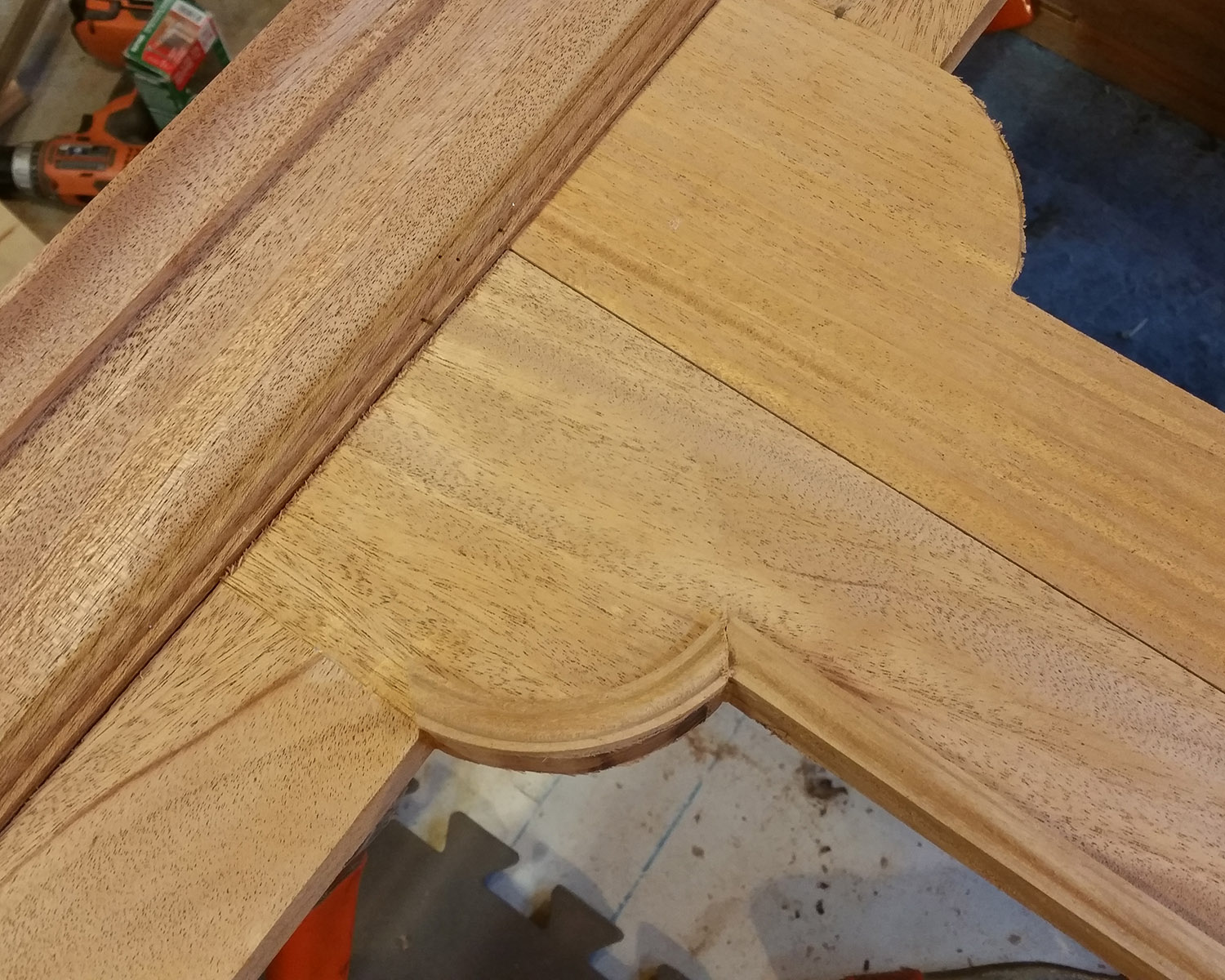 Install the corner pieces as you install the straight sections, and trim them to fit.