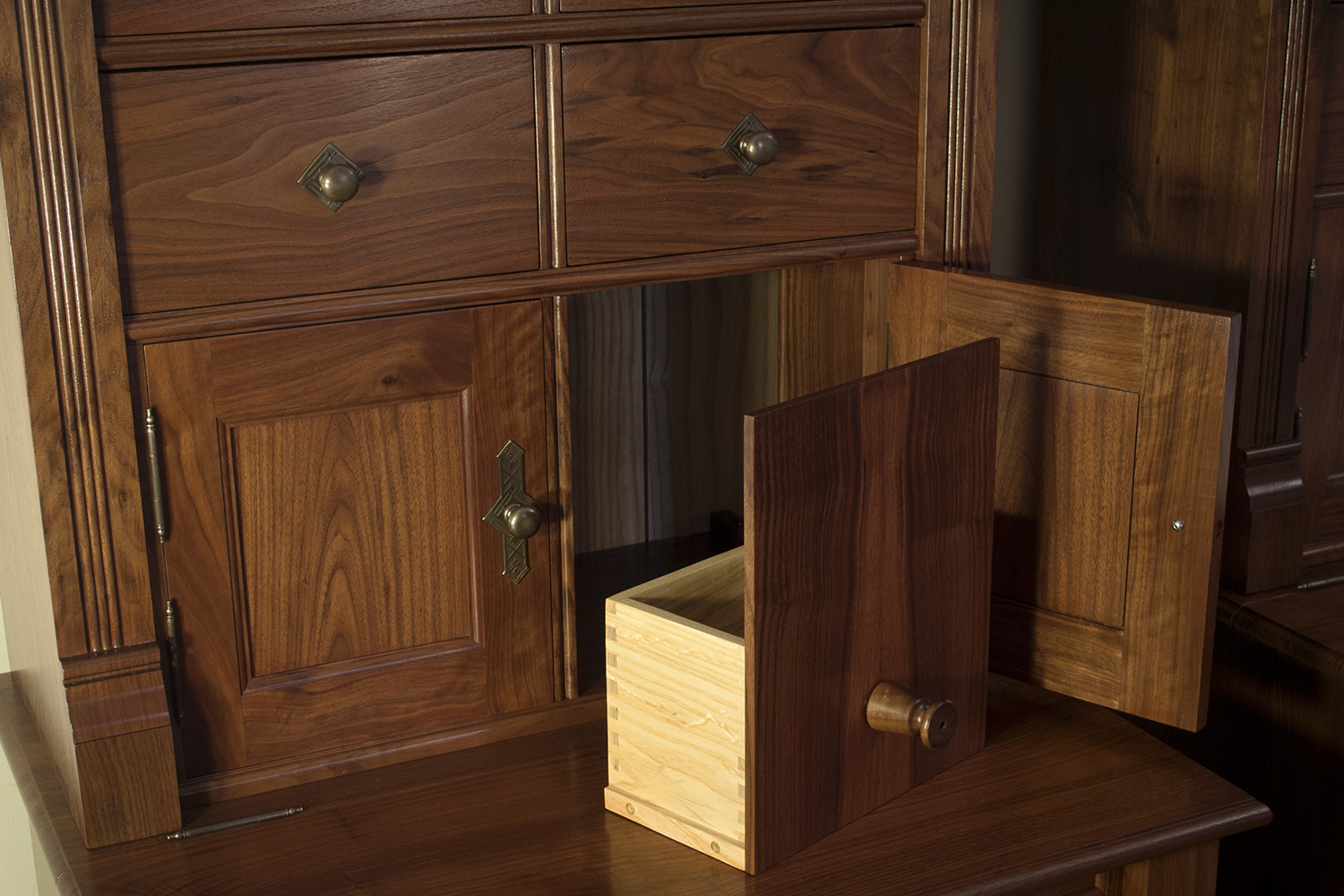 Traditional-Walnut-Bookcases-secret-compartment-detail.jpg