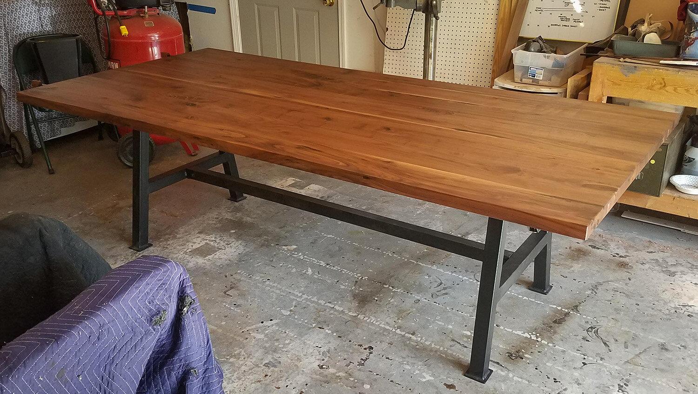 Walnut steel base dining table atlanta.jpg