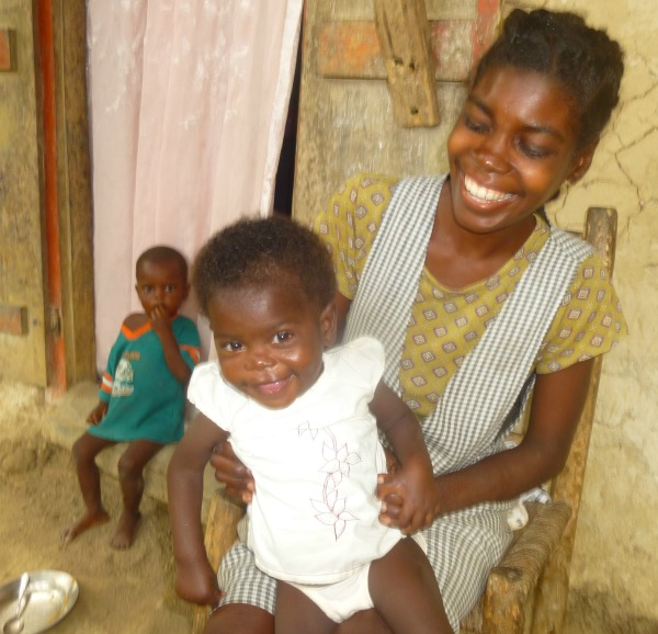 Rosna with Witchana at home, a few months after their short 15-day stay at Second Mile Haiti.