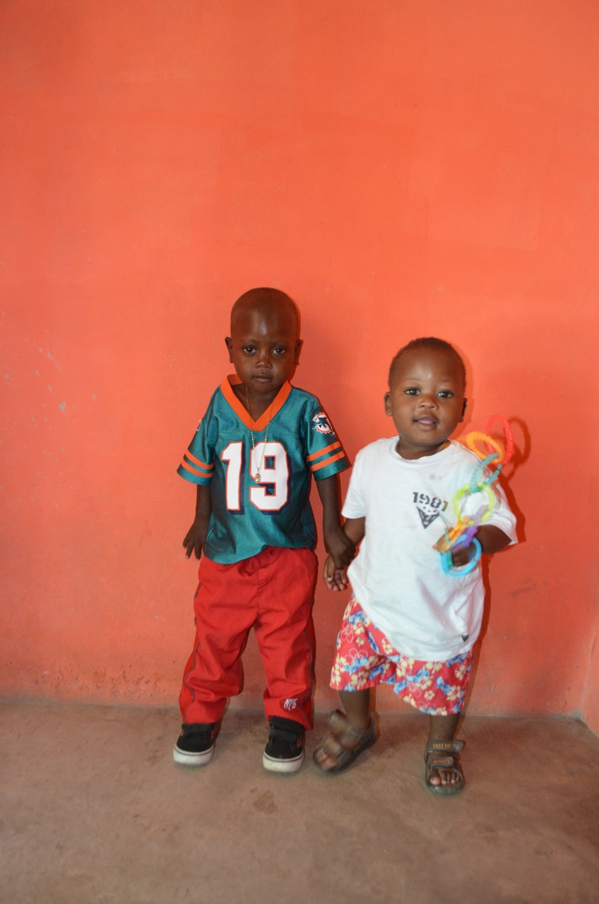 Woodson, age 4 (left), recovery from severe malnutrition,takes hold of his brother Djeff (Age 1 year)