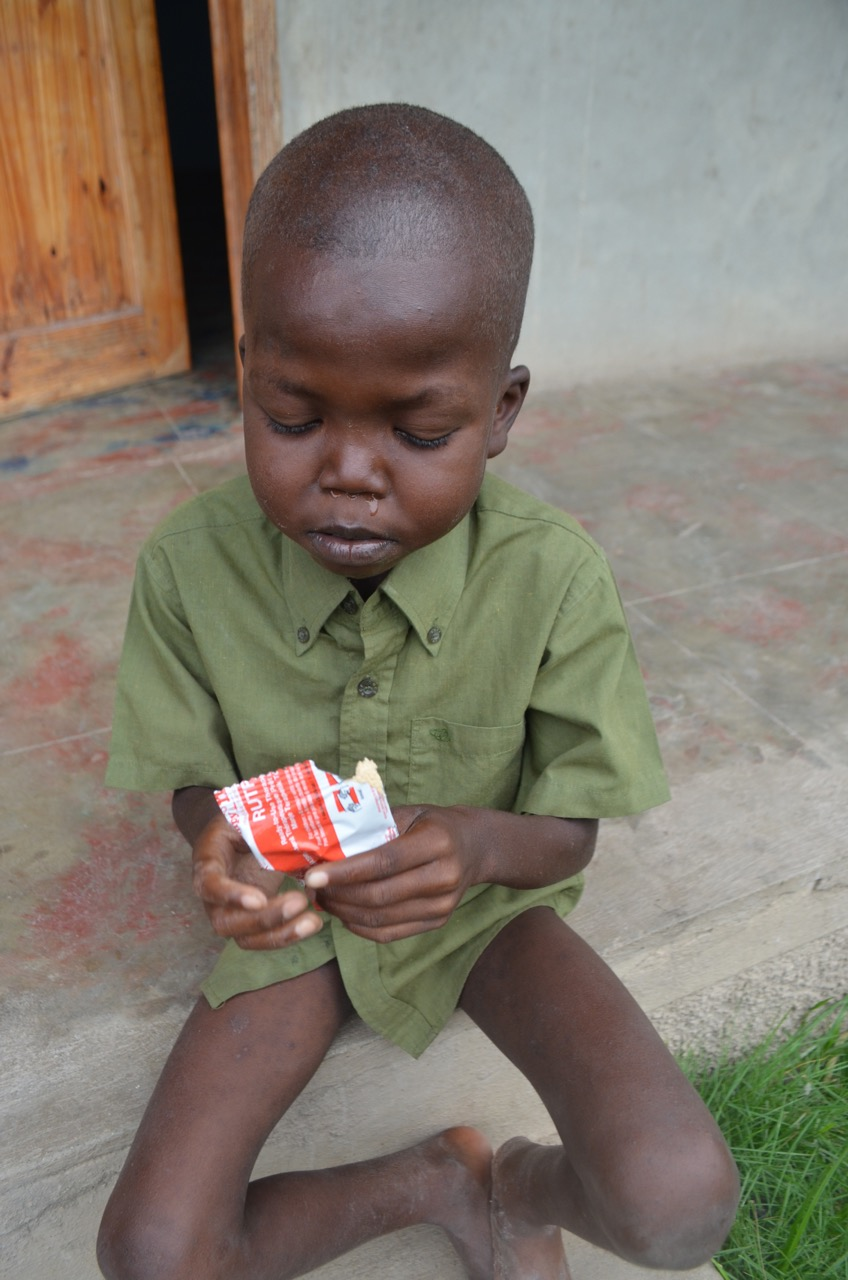 Kely with Medika Manba (RUTF) produced by Meds and Foods for Kids (Cap Haitien). Typical treatment 8-10 weeks.