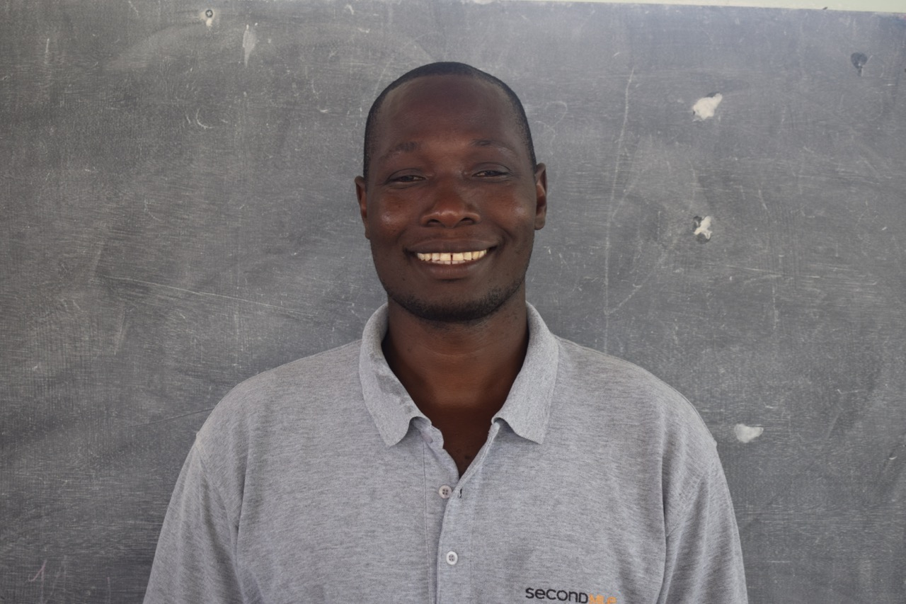 Herode Jean Pierre - Operations Manager - Each day is quite different for Herode, as we rely on him to grease the wheels of the Second Mile operation. He began working with Second Mile while the malnutrition site was still under construction. He was referred from another employee to begin working with Second Mile and has been an integral part of the logistics team ever since. Initially he drove a motorcycle, running and errands and doing odd jobs. Now he and Jenn work together closely to ensure everything that needs doing gets done. Being from the community, Herode believes that seeing so many previous programs beneficiaries refer friends and neighbors is one of the many ways we see the real impact of the program. Besides working and spending time with his family, Herode is learning english, so if you come visit, make sure to chat with him!