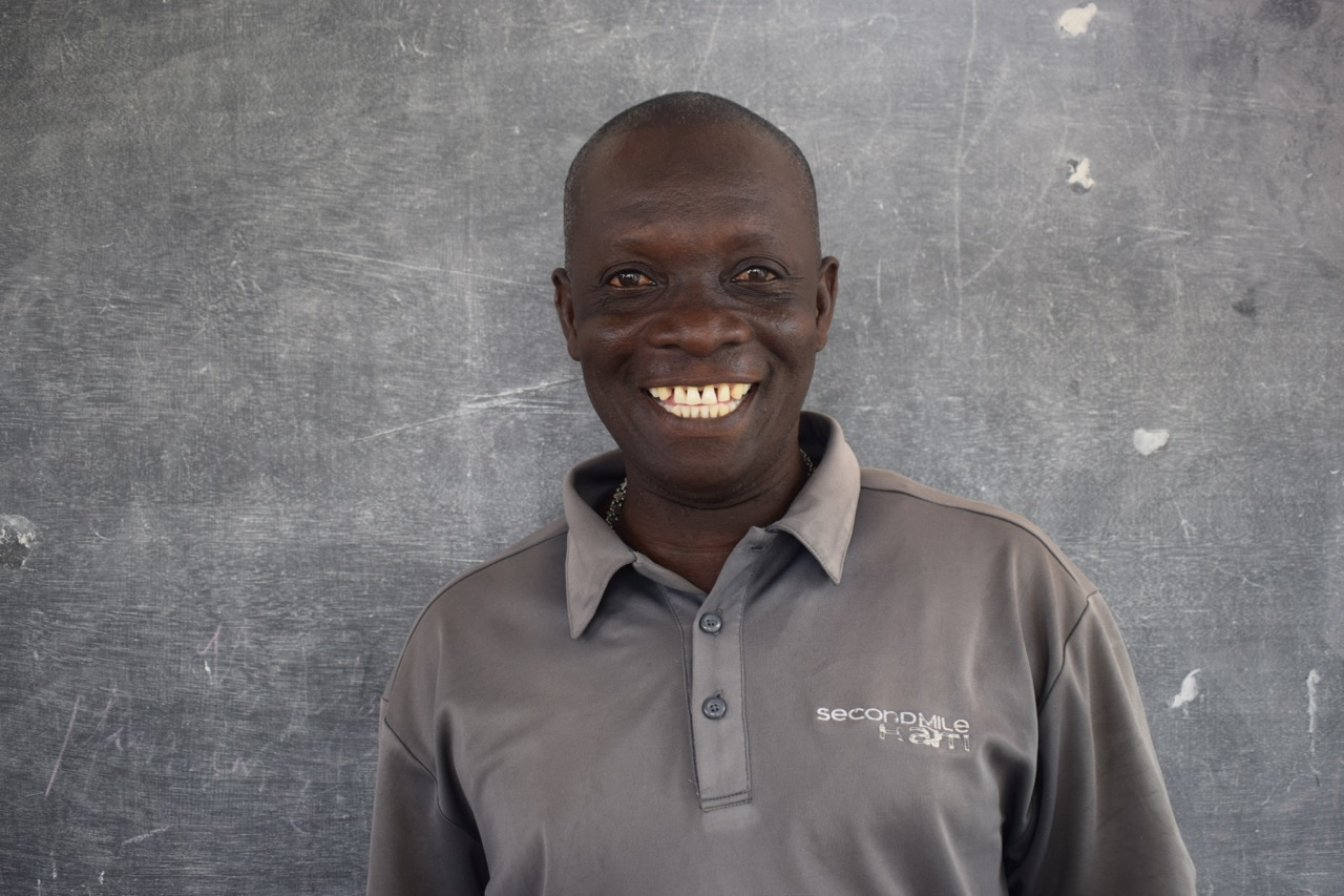 Verdieu Bein Aime - Chaffeur - Verdieu has worked for Second Mile for six years, and he and his wife live in the community surrounding Second Mile facilities. While his role isn't medical, it is vital to the health of our families. He is known fondly as
