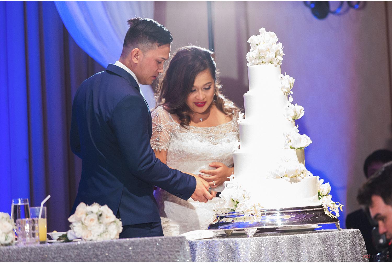 OA_Mimi_+_Lex_43.Reception_cake_cut_Halekulani_Ballroom.jpg