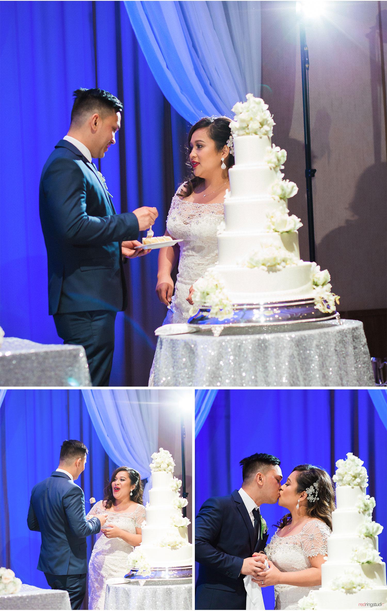 OA_Mimi_+_Lex_44.Reception_cake_cut_Halekulani_Ballroom.jpg