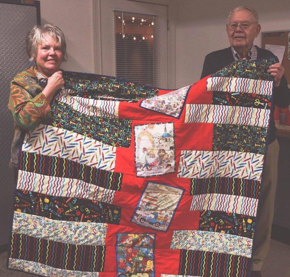 This customer, Gene Murdock, brought in this quilt made with drawings her Dad colored and she copied onto fabric. What an awesome idea!