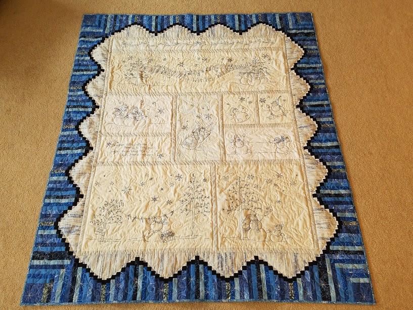 Deanna's embroidered snowmen quilt from Week 17