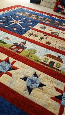 Lynette's husband's retirement quilt from Week 6