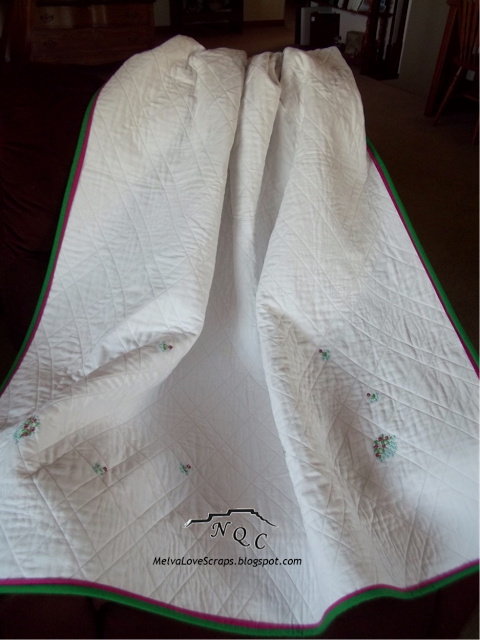 Melva's hand-embroidered tablecloth quilt from Week 19