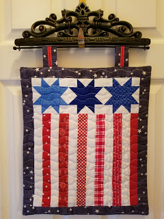 Kathy wallhanging from free pattern Moda Stripes and Stars pillow.jpg