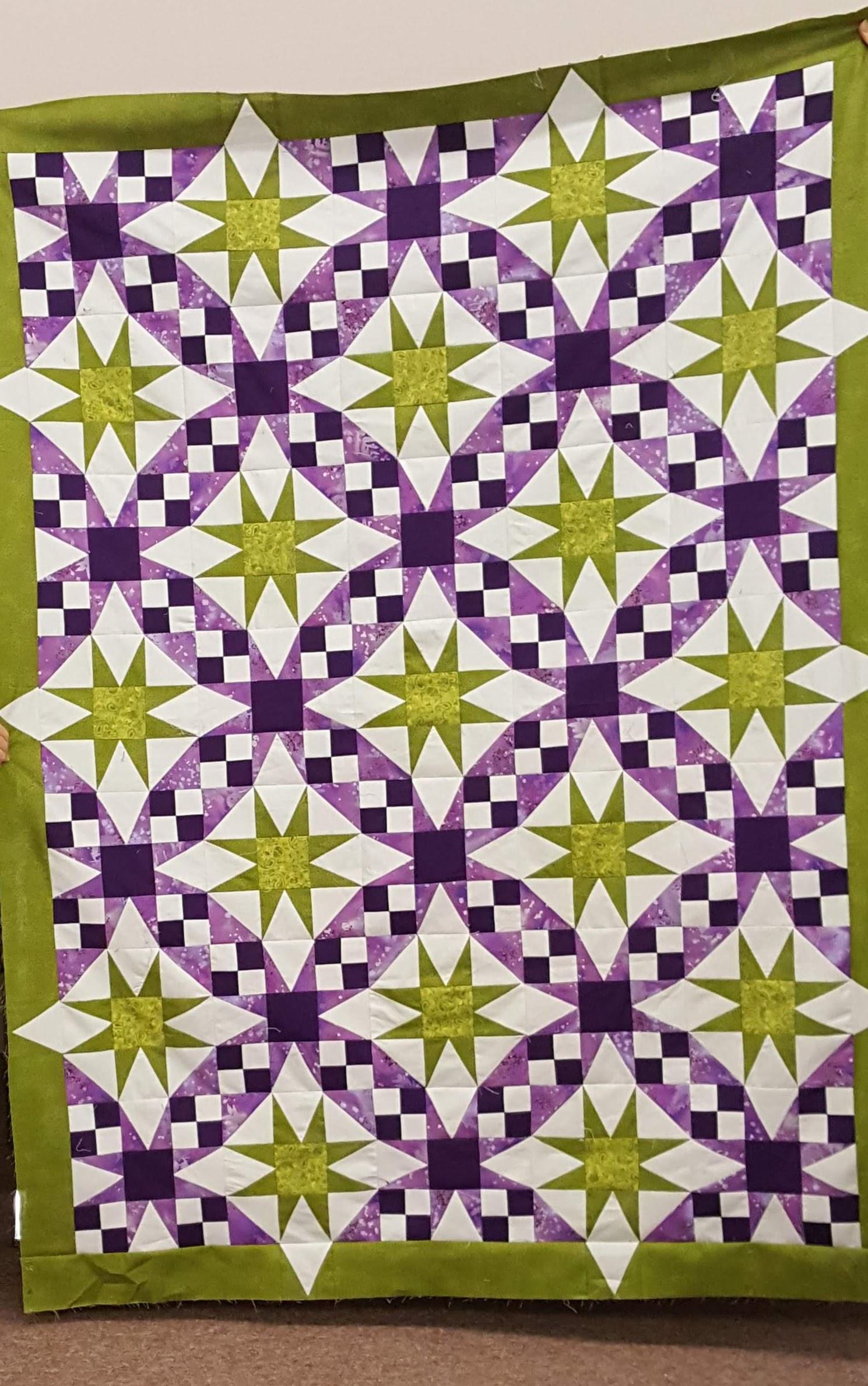Yvonne purple-and-green-galaxy-quilt.jpg