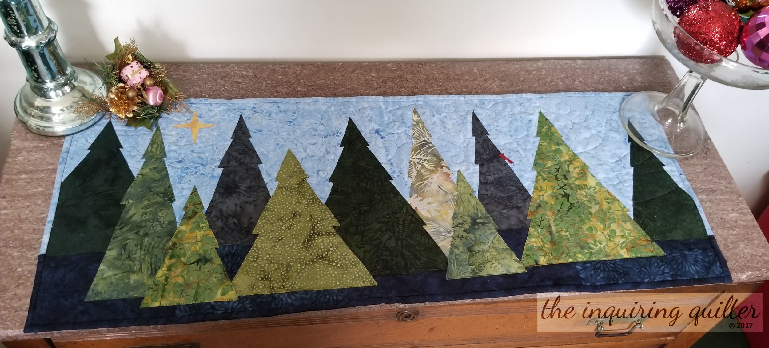 Silent Witness was my Island Batik December 2017 challenge quilt, and one of my favorites for this time of year.