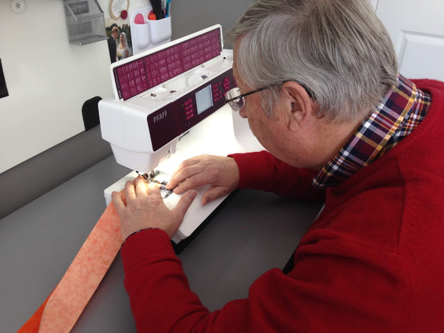 Jen father in law making amish quilt.JPG