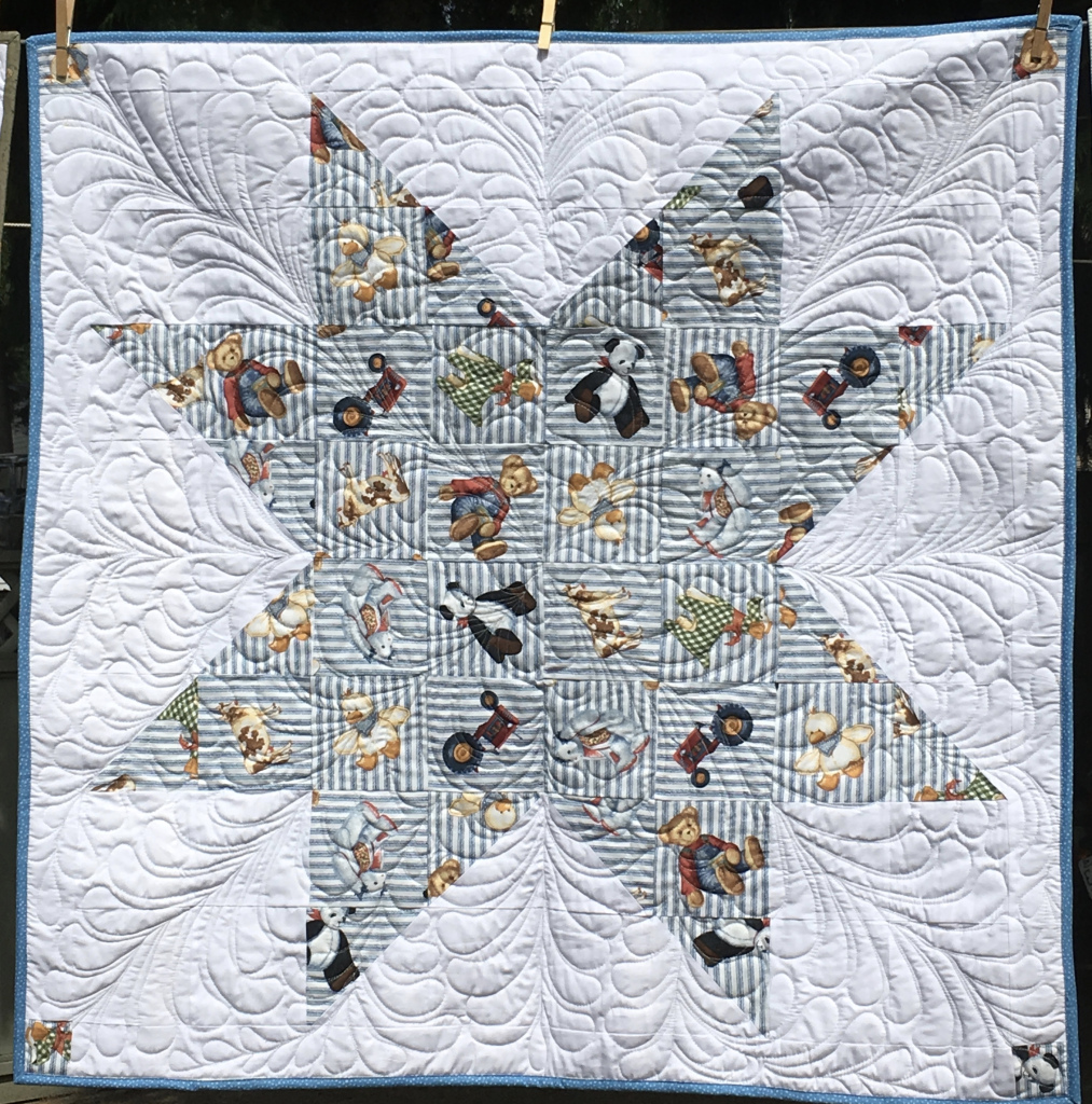 Gail webbed baby quilt.jpeg