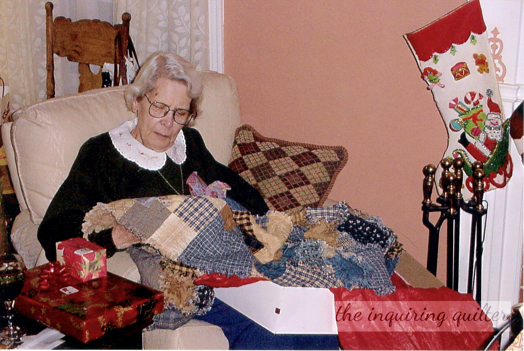 Mom admires the flannel rag quilt 002.png