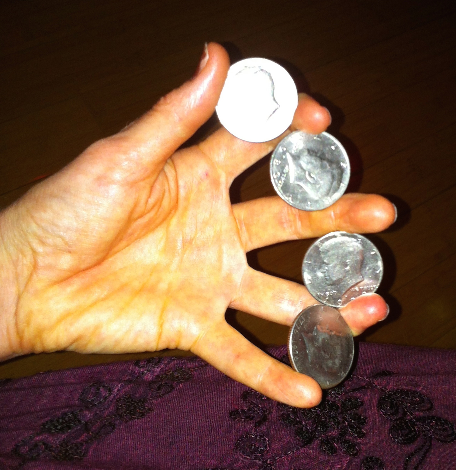 Heather_Rogers_Magician_Four_Coin_Rollout.jpg