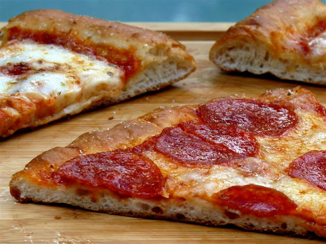 ButterYum's Pizzeria Pizza. how to make pizzeria pizza at home. how to make restaurant pizza at home. 10 tips for the best homemade pizza. how to make restaurant style pizza at home. how to make pizzeria style pizza at home. how to make the best pizza at home. pizza stone pizza recipe.