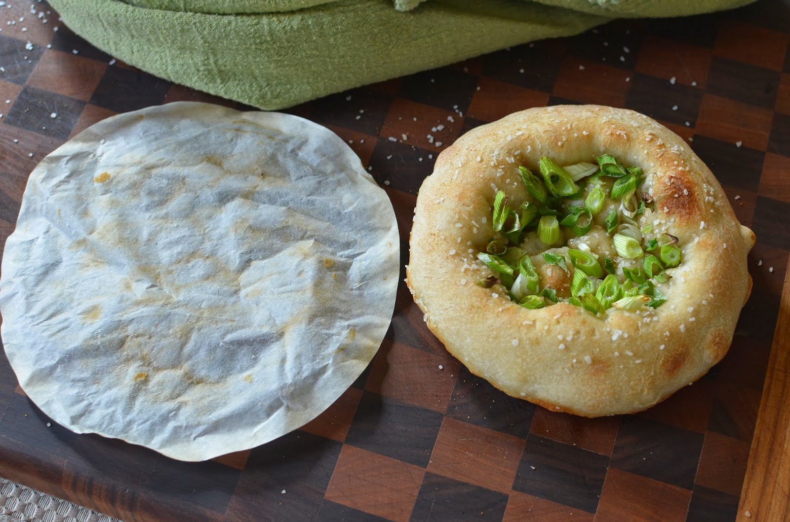 I love using  parchment  when I bake bread - no messy flour or cornmeal burning in my oven