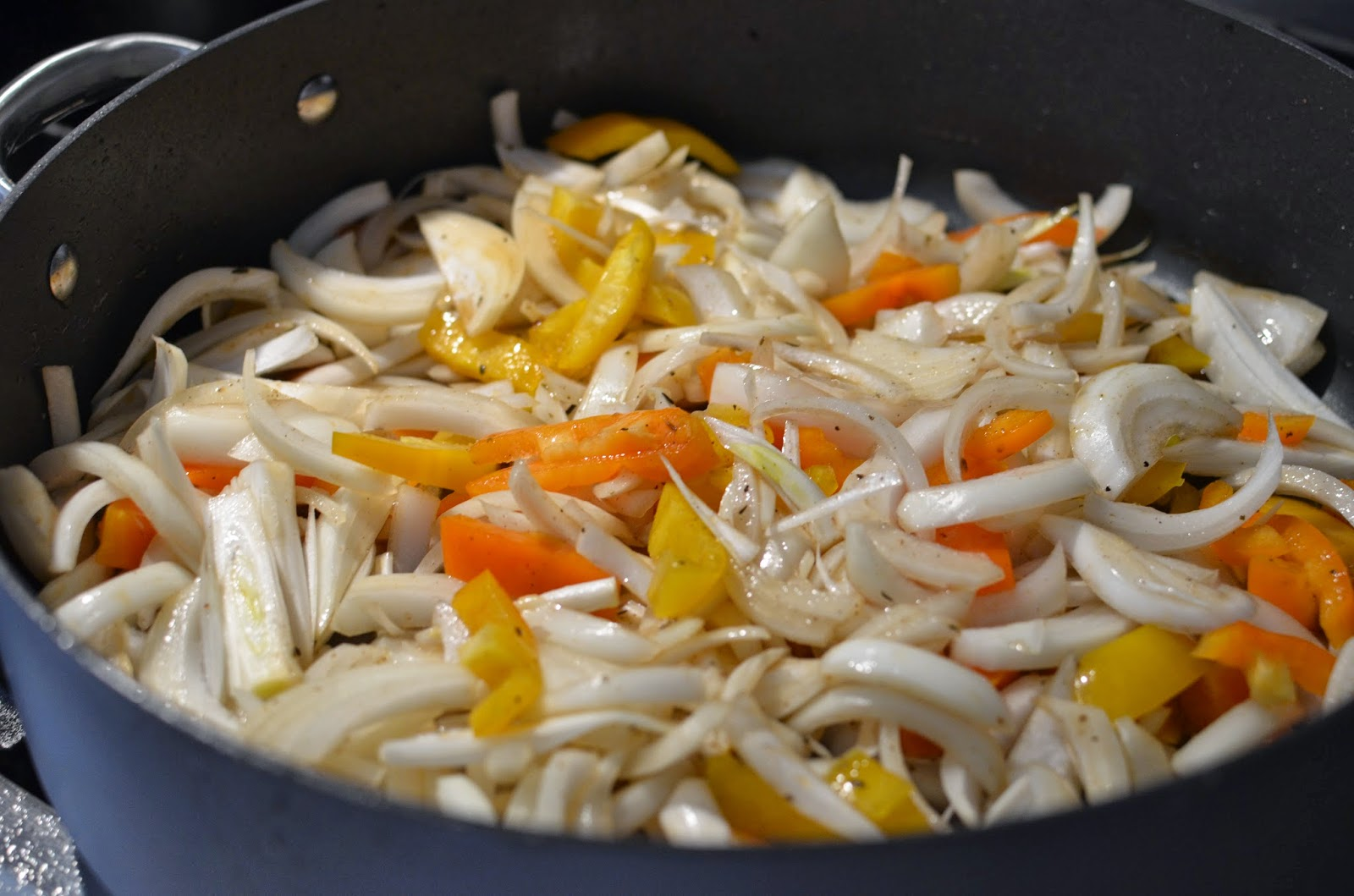 Add a mountain of sliced onions and peppers. Cook, stirring occasionally, for 8-10 minutes.