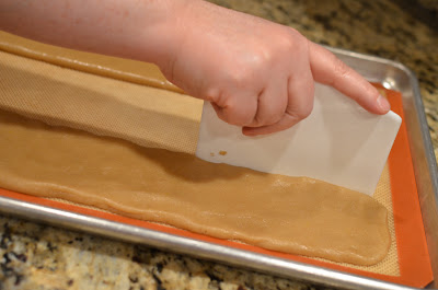 You don't have to do this, but I like to use a pastry scraper to make the edges nice and neat.