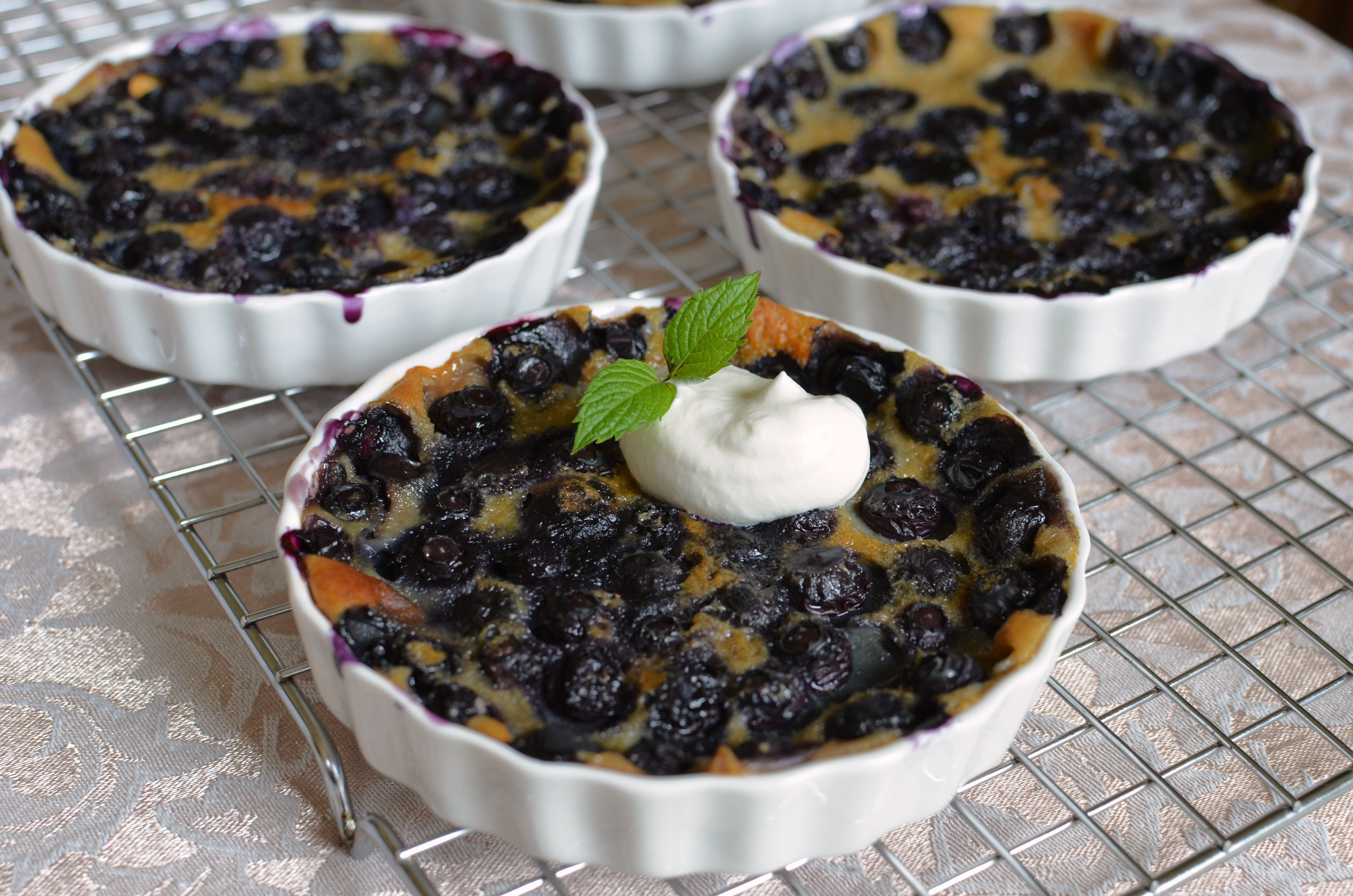 Mini Blueberry Clafoutis - ButterYum. individual clafoutis recipe. how to make clafoutis. French dessert. French custard dessert recipe. How to make clafoutis. can I any fruit to make clafoutis? clafoutis recipe. simple clafoutis recipe.