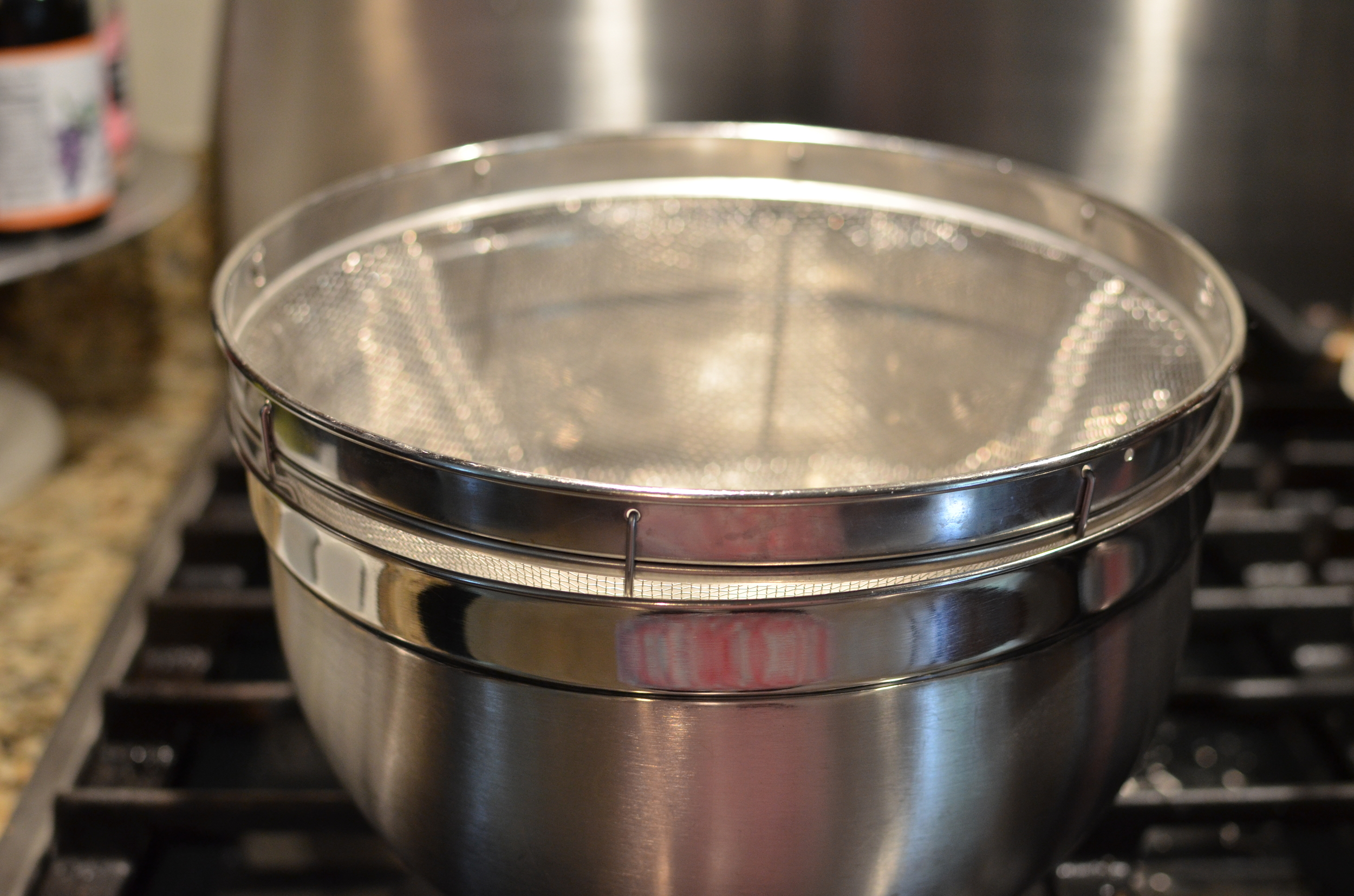 A large bowl and large mesh sieve or colander.
